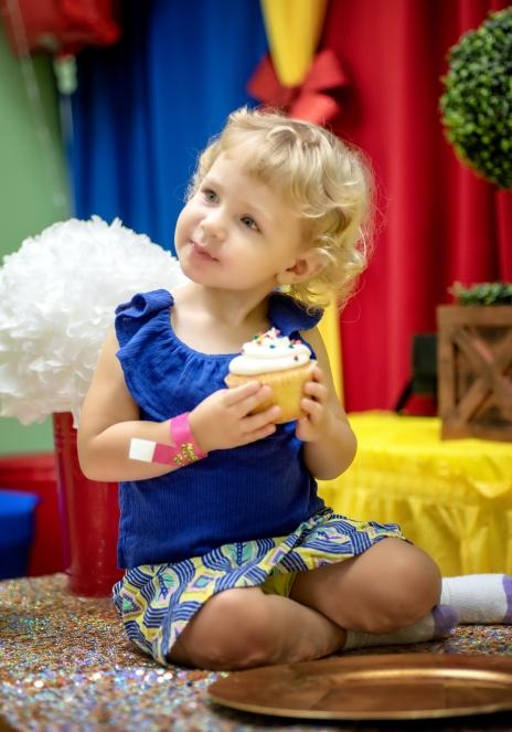 Ruby noshing cupcake III