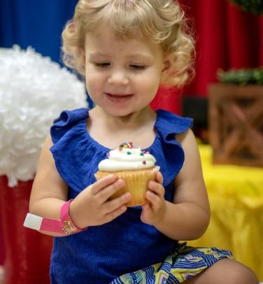 Ruby noshing cupcake IV
