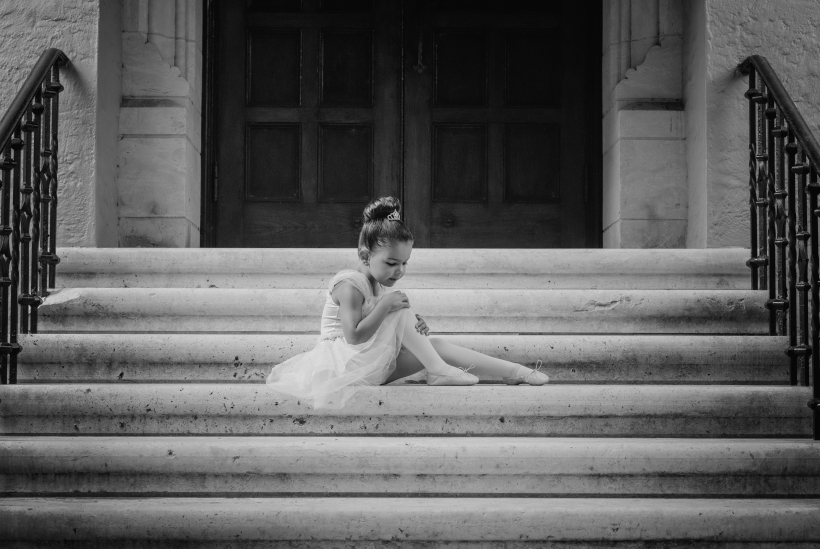 Aurora seated on Knowles steps B&W